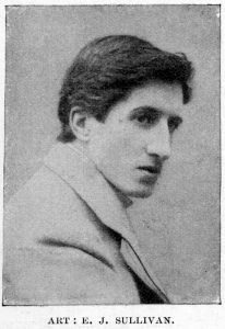 E.J. Sullivan is shown in a head-and-shoulders pose, his body facing the left, and his head angled slightly towards the camera. He is in a light suit jacket with a creased shoulder, and his shirt collar is just visible above the jacket. His lips are slightly parted, and his dark hair is brushed back off his forehead.