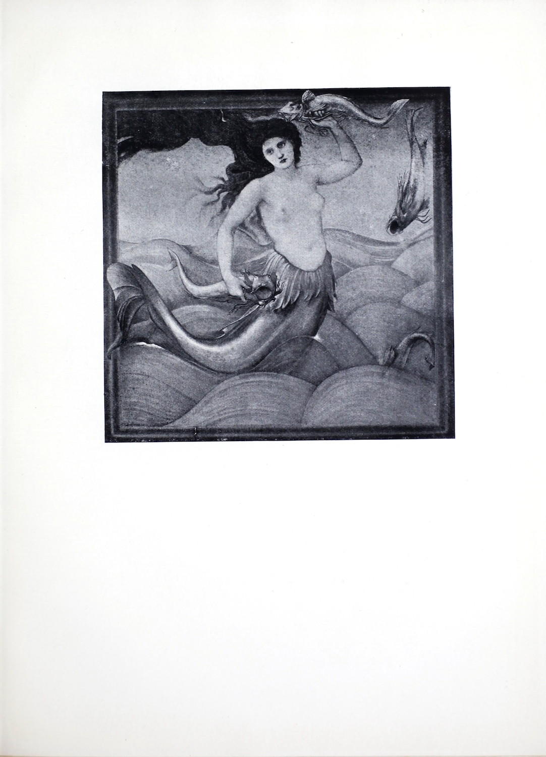 The halftone reproduction of Edward Burne Jones' 1881 painting of a mythical sea nymph leaping across a tumultuous ocean surface is framed and centred on the page in portrait orientation. The sea nymph, or mermaid, is facing the viewer. Her upper body is of a human female. Her lower body is of a fish. Her hair is loose and waves through the air, taking up much of the upper left corner of the image. Her head is tilted to the left. Her left arm is raised up and she holds one fish above her head. The right arm rests at her side where she grips a second fish. She has a ridge of fins skirting her lower torso where her fish form begins. Her tail swings out behind her to the left of the image.