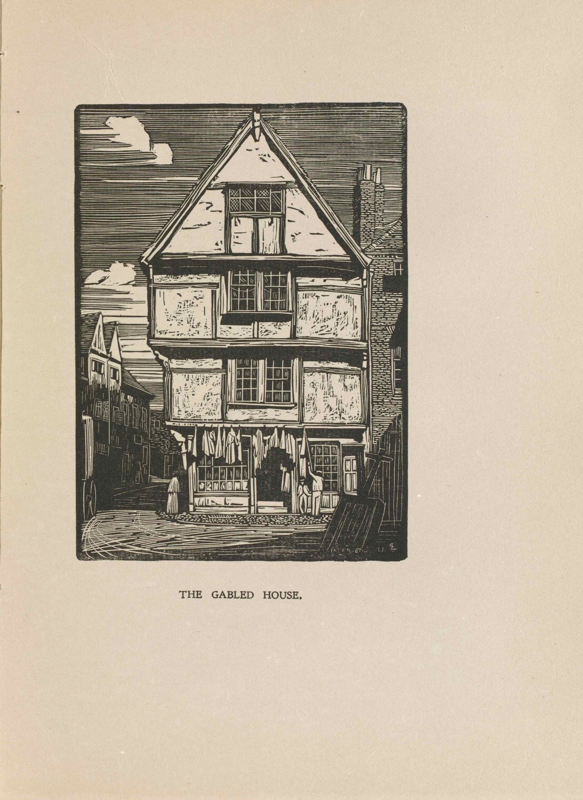 The image is in portrait orientation and is centered on the page within a rectangular border. The image printed in black ink. The front of a lightly coloured Tudor-style house is centered in the foreground of the image. The house is on the corner of a street and is four stories high. There are two-paneled windows in the middle of every story except for the first floor. Each storey slightly increases in length from the bottom to the top, protruding on the left. The house is attached to a bricked building on the right. The brick building is only partially depicted. There are three small figures depicted in the image. Two men are positioned to the right of the house's front door. One is leaning on the door frame facing forward, and the other is facing towards the front of the house. A woman is standing at the corner of the street, to the left of the house. In the bottom left foreground, a carriage is entering the image. A shovel is positioned close to the front of the image's bottom right. In the background left, more houses line the street but are darkened by the shadow of the house in the foreground.