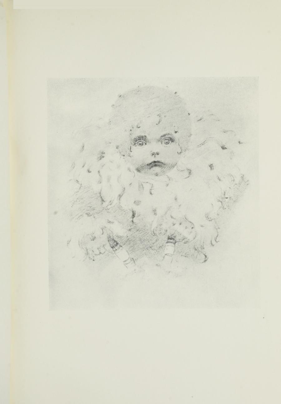 Image is of an infant in full face The child has full light coloured curly hair The child is holding on to two unidentifiable objects The background is light and undefined The image is vertically displayed