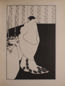 Image is of a full length woman standing at a dressing table in a bare room decorated with striped floral wallpaper She is in the middle of the frame dividing the image in half vertically She has black hair and is wearing a very large white bed jacket over a formal dress with train The woman is shown in profile looking to the left at what may be a mirror The dressing table is decorated with bows and lit by two tall candles The image is vertically displayed