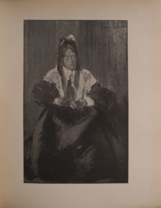Image is a portrait of a woman or perhaps of a man dressed as a woman seated wearing a lace shawl over a black dress Her hair is dark coloured styled in braids She takes up approximately 3 4 of the image The black dress she is wearing blends into the background which is open The artist s signature is in the upper right hand corner The image is vertically displayed