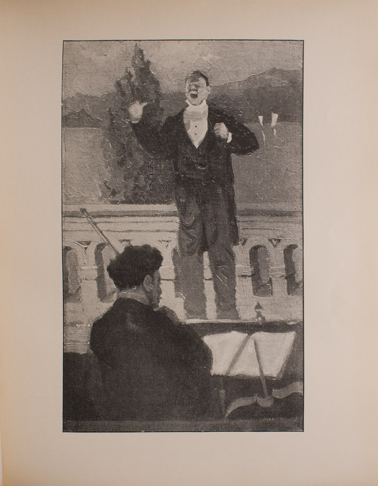 Image is of an interior performance scene In the foreground there is a man playing violin who is standing with his back to viewer facing an open book on his music stand Another violin is visible in the bottom right corner The musician and the two violins take up approximately 3 4 of the lower portion of the image In the middle ground there is a male singer in evening dress standing above the musician on stage his mouth is open in mid song He is holding his hands in mid air clenching them in fists The stage divides the image in half horizontally In the background there is a painted stage set it shows an arched wall a tree a body of water and several hills The image is vertically displayed