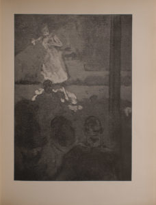 Image is of the interior of a music hall In the foreground there are the backs of men s heads in the audience They are all seated in darkness To the right of the men there is a large pole that divides the image vertically The stage cuts the image in half horizontally separating the foreground from the background In the background there is a light haired woman standing on the left side of the stage a spotlight illuminating her She is wearing white The image is vertically displayed