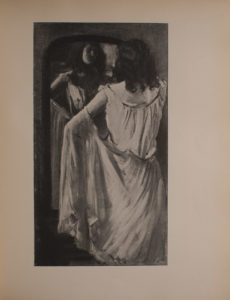 Image is of a young dark haired woman standing before a framed mirror fastening white skirt at the waist Her back is toward the viewer but her face is visible through the reflection of the mirror She is shown from the hemline up with her body taking up approximately 3 4 of the image The walls of the room are unadorned and light-coloured The image is vertically displayed