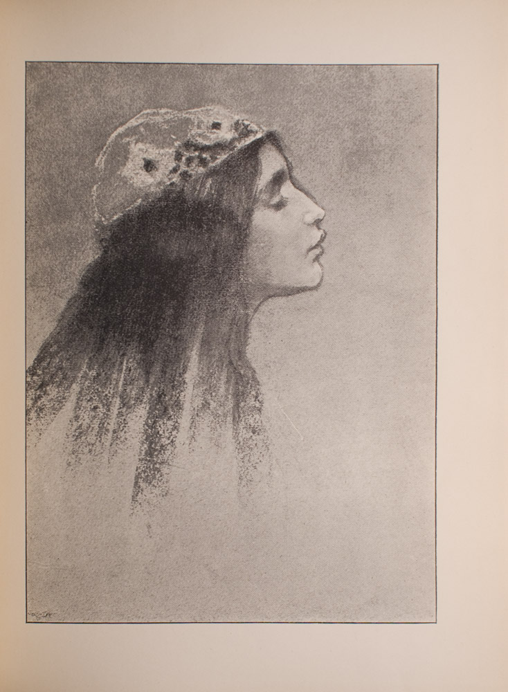 Image is of the head of a young woman with long dark hair in profile facing right She is wearing a white patterned cap and her eyes are closed The image is vertically displayed