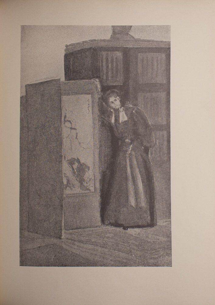 The image is of a woman in a long dress beside a folding screen The woman is to the right of the screen and has her right hand resting on the top corner of the screen Her left hand is hidden behind the skirt of her dress Her torso and head are slightly bend towards the screen and her gaze is to the right Her dress has light coloured material around the collar and a light coloured sash around the waist There is a pattern on the inside of the screen Behind the woman is an armoire or a bookcase The image is vertically displayed