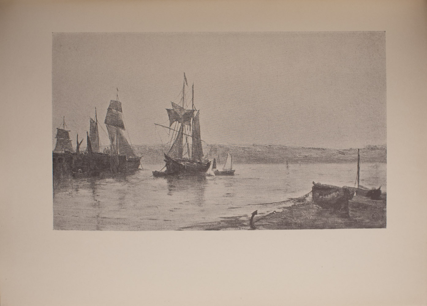 The image is of a waterside scene In the left middle ground are three large anchored boats with sails Immediately to the right of the larger boats is a small boat with sails In the right foreground there are two small boats with no sails anchored to the shoreline In the background another shoreline is visible The image is horizontally displayed