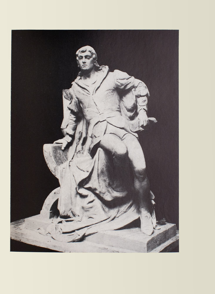Image is of a statue of a man He is shown in full leaning on a chair covered by a cloak The man is wearing a belted jacket and stockings both are light coloured The jacket has puffed sleeves His right arm is clutching the chair supporting him his left hand is clutching a sheaf of paper His left leg is slightly bent with a flexed foot the right leg is tucked in to him the lower half of it disappearing into his shadow He is wearing pointed shoes His facial expression is stoic with a straight chin and a forward gaze The background is black and undefined The image is vertically displayed