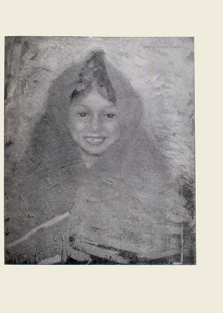 Image is of a young girls head and torso She has dark hair that is tucked under a shawl the part is visible The shawl wraps around her head shoulders and a portion of her chest She is looking forward and smiling The girl has a tooth missing The image is vertically displayed