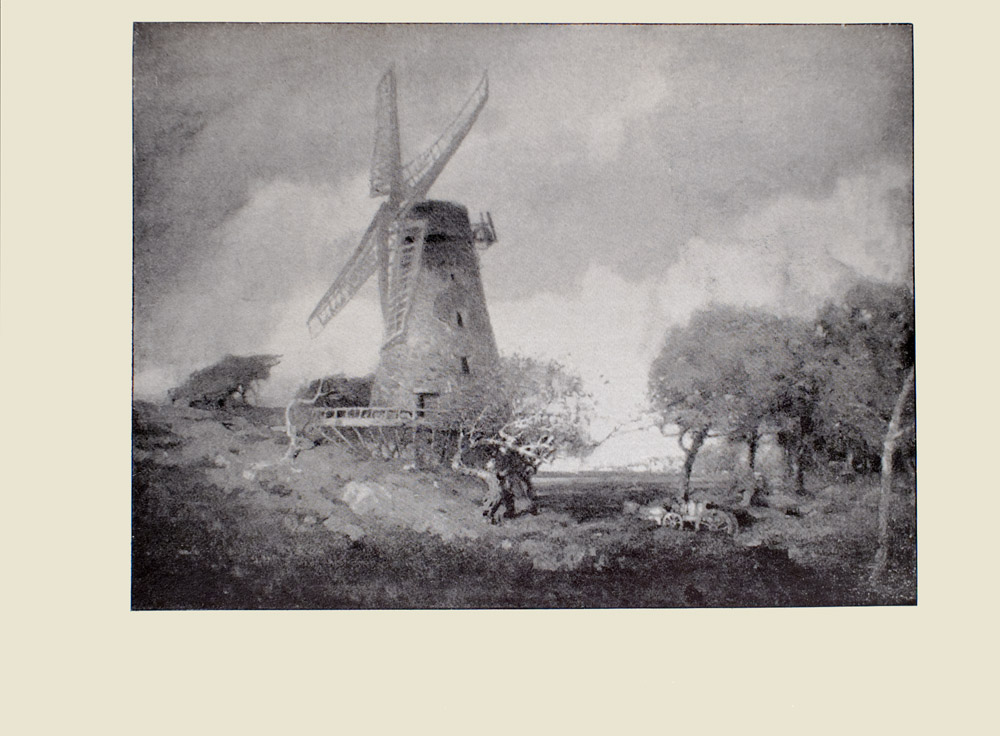 Image is of a windmill in a field The windmill is made out of stone with four shuttered blades these blades divide the image in half vertically The windmill is placed atop a stage Behind and to the right of the windmill are clusters of trees several craggy trees are also in front of it There is horse and wagon in the grass on the right The sky is light with several clouds The image is horizontally displayed