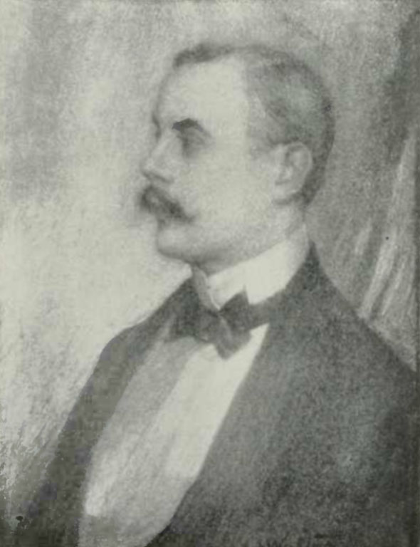 The image is of Kenneth Grahame in profile facing left. He is wearing a dark tuxedo jacket, a white collared shirt and a dark bowtie. He also has a moustache. The image is vertically displayed.