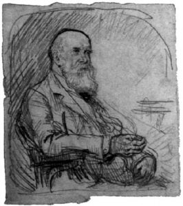 Image is of John Trivett Nettleship sitting on a chair. He is shown from the waist up. He is wearing a suit and tie. His body is in profile, facing right. He is shown in ¾ face. He is balding with hair remaining on both sides of his temple; he also has a long, bushy beard and a moustache. His right arm is resting on the arm of the chair; it is held in a loose fist. His left hand is resting on his leg. The background is undefined. The image is vertically displayed.