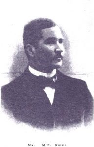 Image is of M.P. Shiel shown from the shoulders up with ¾ face. He is looking to the right. He is wearing formal dress with a bow tie. The background is open and light coloured.